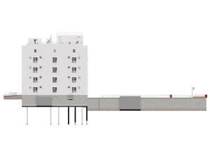 Боковой фасад многоэтажного дома с подземным паркингом